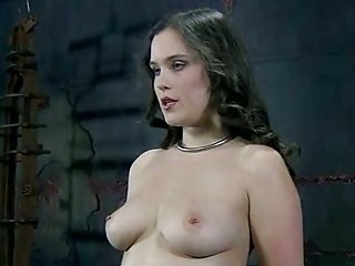 Busty girl receives hard toying while tied up BDSM porn