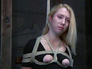 Tempting blonde tries to free herself with scissors from slavery