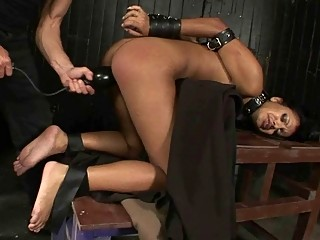 Sexy exotic girl bound and dominated by a muscular man