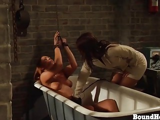 Lesbian slave is chained up and she begs for mercy