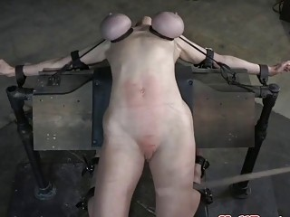Short-haired blonde slave is tied up and tortured by sadist