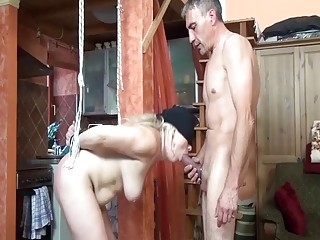Sadistic dude ties up mommy and teases her pussy gently