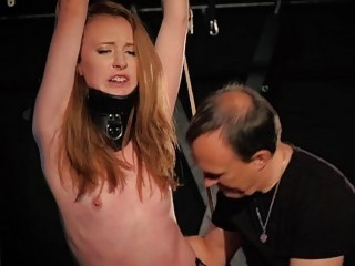 Chick with small titties is tied up and whipped hard