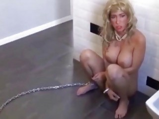 Blonde MILF in the bathroom chained up waiting for master