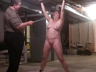 Granny with huge titties gets caned and pussy teased gently