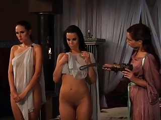 Lesbian babe forces her girlfriends to strip their see-through clothes
