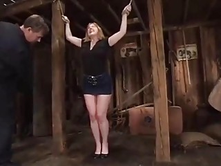 Mature woman with big titties is tied up and tortured