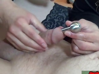 Stroking the cock and sounding it a bit as well