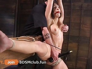 Punishing a cute whore with two dildos at a time