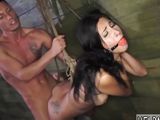Gorgeous naked tattooed babe enjoys bondage and rough BDSM fuck