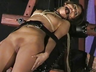 Submissive naked girl enjoys BDSM and bondage with her master