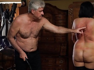 Submissive girl in stockings enjoys BDSM with a mature man