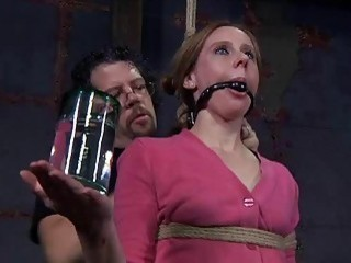 Cute gagged and bound woman feels the extreme pain BDSM