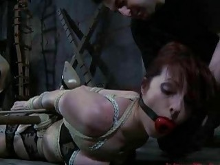 Redhead lady gets tied up and toyed by master BDSM