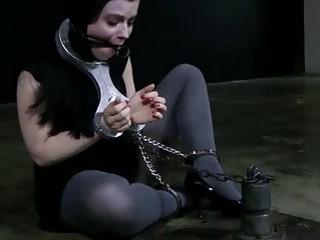 Bound skank in stockings locked up in sex dungeon BDSM