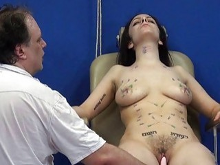 Charming brunette is getting a punishment in a form of needles