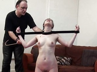 Bond and blindfolded brunette slave is punished with hot wax