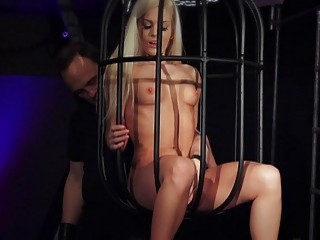 Naughty blonde gets in cage and is whipped very hard