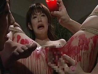 Attractive Asian screams in bondage while being tortured with a candle