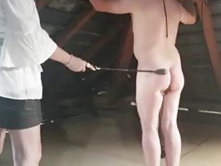 Male Whipping session with tied up slave and mistress BDSM