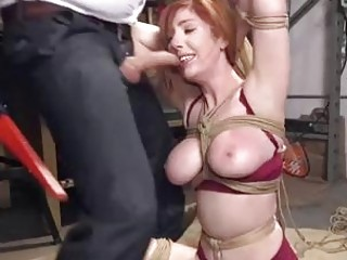 Curvy redhead woman roped and dominated by maledom master BDSM