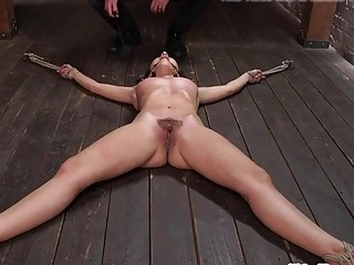 She's restrained and her pussy is whipped by her master