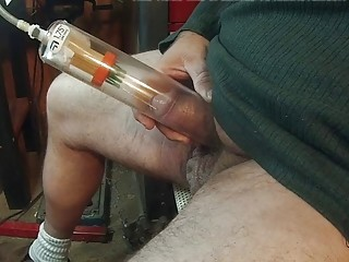 He puts his cock in a little suction pump alone