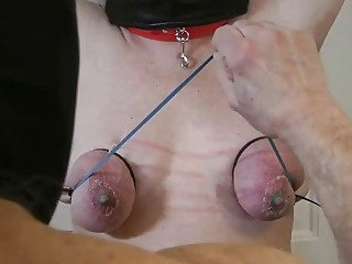 Chick with small pale titties is tied up and milked