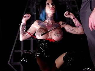 Inked babe tied up and bent over for hot stud