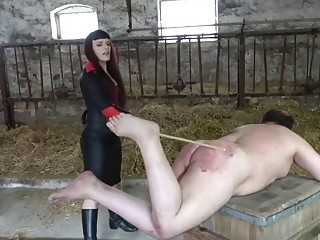 Male slave lays down and gets whipped by horny domme
