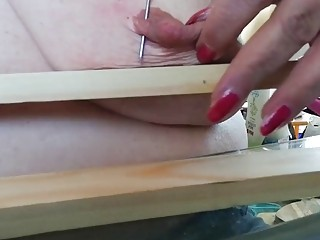 Bitch with big titties shoves nails through her big nipples
