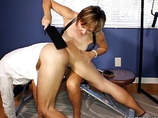 Getting his ass spanked by horny lesbian babe and moaning