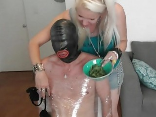Male slave tied up and forced to eat some grass