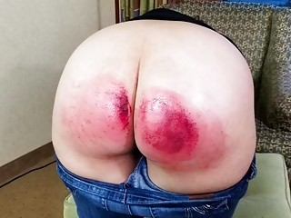 Big booty chick bends over and gets spanked real hard
