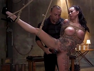 Inked chick is tied up and fucked hard by master