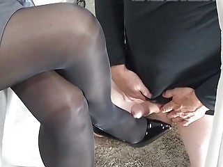 Slave forced to rub cock against her black high heels
