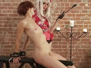 Skinny short-haired redhead gets wax on her body from mistress