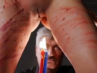 Redhead gets whipped and teased with some candles as well