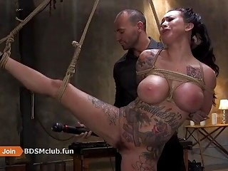 Tattooed brunette enjoys anal sex before having cum all over her tits