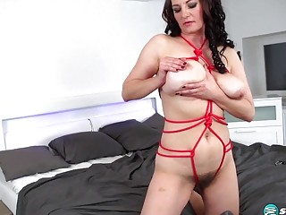 Busty brunette milf with big breasts enjoys being tied