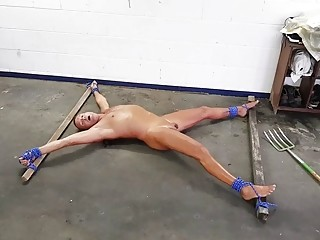 Naked man exposed to BDSM and bondage on the floor