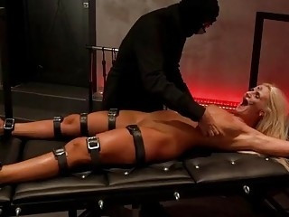 Gorgeous naked slave girl enjoys nasty BDSM and extreme bondage