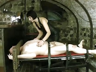 Seductive mistress enjoys BDSM and femdom with her male slave
