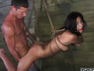 Tied up slave is drilled before receiving cum on face