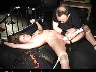 Naked babe enjoys BDSM and bondage with a mature pervert