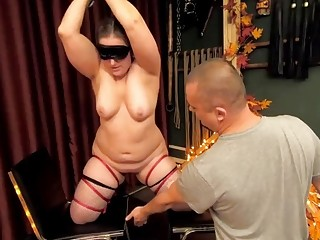 Chubby woman in stockings enjoys kinky BDSM and perverted bondage